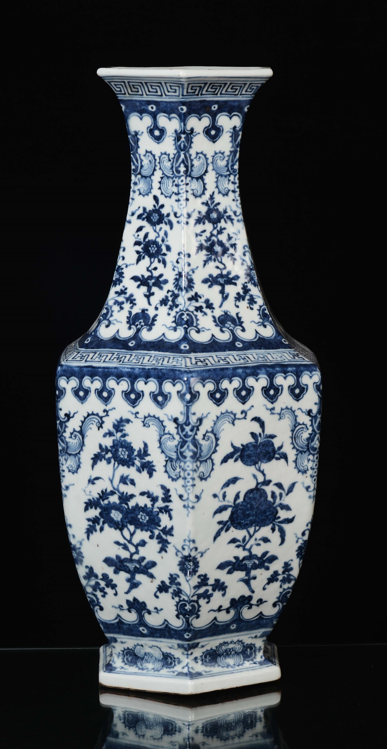 A Large Vase With An Hexagonal Base In Blue And White