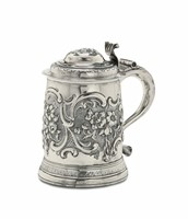 A tankard in silver, molten, embossed and chiselled,  ...