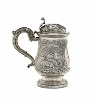 A tankard in Sterling silver, molten, embossed and  ...