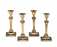 Four candlesticks in molten, chiselled and gilded  ...
