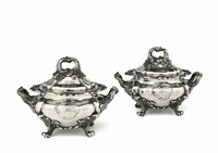 A pair of tureens in molten, embossed and chiselled  ...