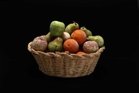 Woven wicker basket with colored wax fruit, Italy,  ...