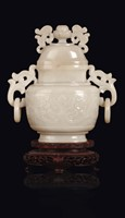 A white jade vase and cover with archaic style motif,  ...