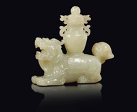 A white jade figure of Pho dog with vase on his back,  ...