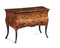 A Louis XV chest of drawers veneered in root wood,  ...