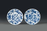Two porcelain plates with a white and blue plant decoration,  ...