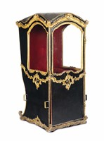 A sedan chair in black leather with profiles and decors  ...