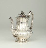 A coffee pot in molten, embossed and chiselled silver.  ...