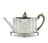 A teapot in silver sterling, molten, embossed and  ...