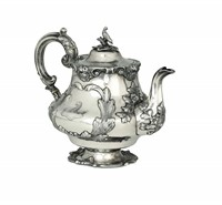 A teapot in sterling silver, molten, embossed and  ...