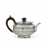 A teapot in molten, embossed and chiselled sterling  ...