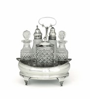 A cruet in molten, embossed and chiselled silver.  ...
