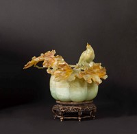 A yellow and russet jade box and cover with branch  ...