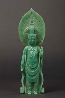 A jadeite figure of deity with aura, China, early  ...