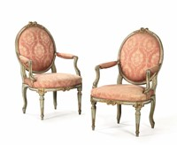 A pair of armchairs in carved, painted and gilded  ...