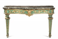 A pair of tables in sculpted, carved, gilded and painted  ...