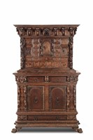 A carved cabinet in walnut and walnut wood with a  ...