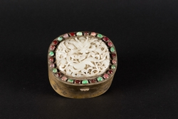 A gilt metal box with a white jade dragon  ...