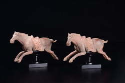 A pair of painted pottery horses, China,  ...