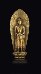 A large and rare gilt bronze figure of a  ...