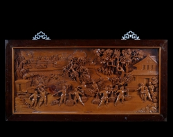 A carved wood panel depicting the start  ...