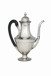 A coffee pot in embossed and chiselled silver,  ...