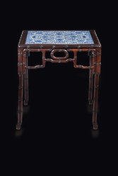 A rare wooden table with blue and white  ...