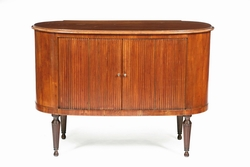 A sideboard with sliding shutters in cherry  ...