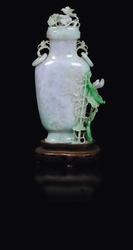 An apple green shades jadeite vase and cover  ...
