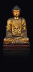 A gilt and lacquered wood figure of seated  ...